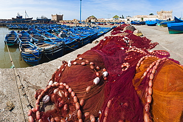 Fishing nets and blue fishing boats in Essaouira Port, formerly Mogador, Morocco, North Africa, Africa