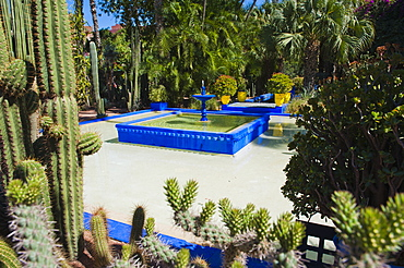 Blue fountain and cactus in the Majorelle Gardens (Gardens of Yves Saint-Laurent), Marrakech, Morocco, North Africa, Africa