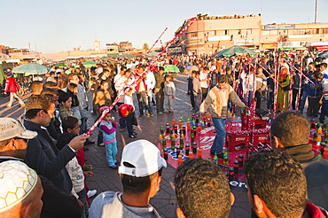 Moroccans playing games in Place Djemaa El Fna, Marrakech, Morocco, North Africa, Africa
