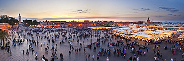 Food stalls, people and Koutoubia Mosque at sunset, Place Djemaa el Fna, Marrakech, Morocco, North Africa, Africa
