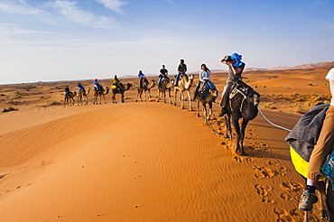 Tourists on a camel ride in Erg Chebbi Desert, Sahara Desert near Merzouga, Morocco, North Africa, Africa
