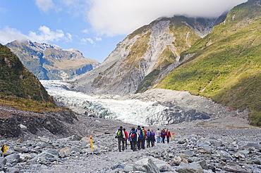 Tourists on Fox Glacier tour, Westland National Park, UNESCO World Heritage Site, South Island, New Zealand, Pacific