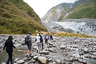 Tourists on Fox Glacier trek, Westland National Park, UNESCO World Heritage Site, South Island, New Zealand, Pacific