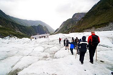 Tourists on Fox Glacier, Westland National Park, UNESCO World Heritage Site, South Island, New Zealand, Pacific