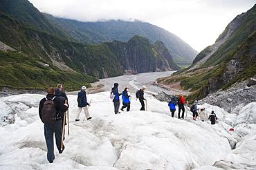 Tourists walking on Fox Glacier, Westland National Park, UNESCO World Heritage Site, South Island, New Zealand, Pacific