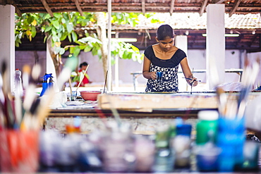 Sri Lankan woman batik painting near Anuradhapura, Central Province, Sri Lanka, Asia