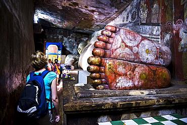 Tourist visiting Cave 1 (Cave of the Divine King), Dambulla Cave Temples, UNESCO World Heritage Site, Dambulla, Central Province, Sri Lanka, Asia
