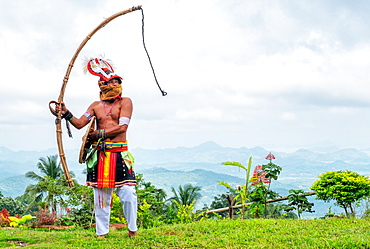 Caci man performing a traditional whip dance with bamboo shield and leather whip, western Flores, Indonesia, Southeast Asia, Asia
