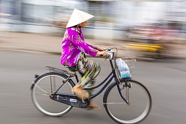 Woman on bicycle, slow shutter speed, Chau Doc, Mekong River Delta, Vietnam, Indochina, Southeast Asia, Asia