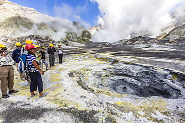 Visitors at an active andesite stratovolcano on White Island, North Island, New Zealand, Pacific