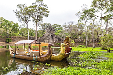 Ornate tourist boats near the South Gate at Angkor Thom, Angkor, UNESCO World Heritage Site, Siem Reap Province, Cambodia, Indochina, Southeast Asia, Asia