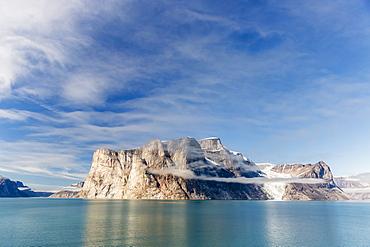 Fog lifting on the steep cliffs of Icy Arm, Baffin Island, Nunavut, Canada, North America