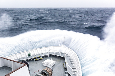 The Lindblad Expeditions ship National Geographic Explorer in heavy seas in the Drake Passage, Antarctica, Polar Regions