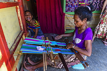 Woman weaving textiles in the capital city of Dili, East Timor, Southeast Asia, Asia