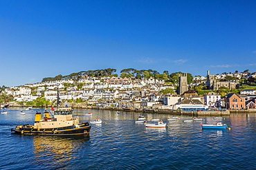 Early morning light on small boats at anchor in the harbour at Fowey, Cornwall, England, United Kingdom, Europe