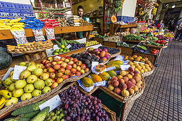 Vendors inside the Funchal Market, where fresh produce and fish are sold in Funchal, Madeira, Portugal, Europe