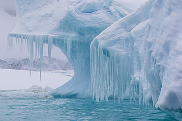 Wind and water sculpted iceberg with icicles at Booth Island, Antarctica, Polar Regions