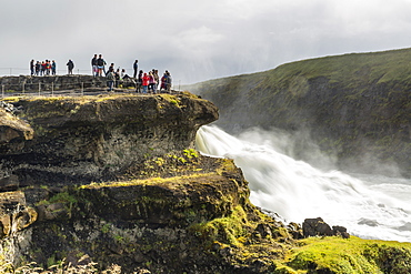 Tourists visiting Gullfoss (Golden Falls), a waterfall located in the canyon of the Hvita River in southwest Iceland, Polar Regiions