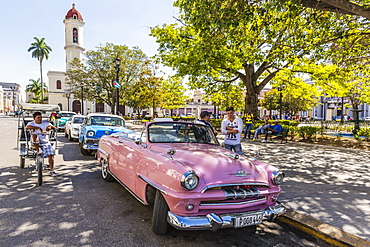 Classic 1950's Plymouth taxi, locally known as almendrones in the town of Cienfuegos, Cuba, West Indies, Caribbean, Central America