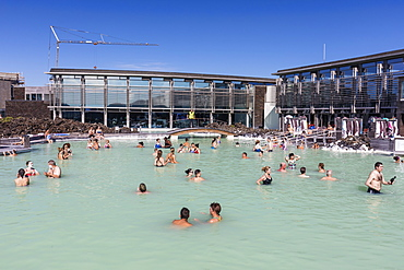 Guests enjoy the thermal waters of the Blue Lagoon (Blaa Ionid), Iceland, Polar Regions