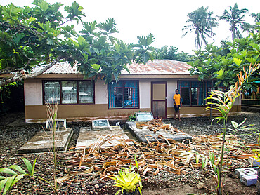 Ancestors graves in the front yard of a home in the town of Lufilufi on the island of Upolu, Samoa.