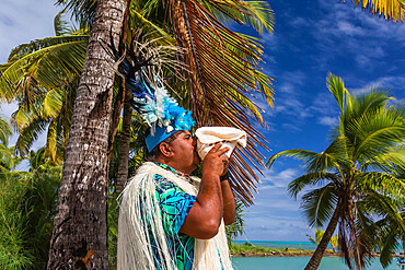 A conch shell blowing warrior welcoming guests to Aitutaki, Cook Islands.
