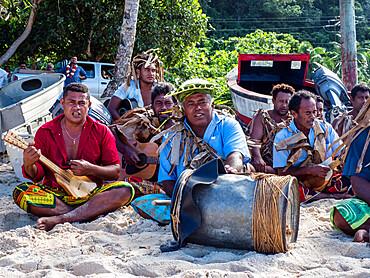 Local musicians greeting visitors on Vele Beach, Futuna Island, French Territory of Wallis and Futuna Islands.