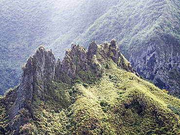 Interesting volcanic rock formations surrounding the town of Hanavave, Fatu Hiva, Marquesas, French Polynesia, South Pacific, Pacific