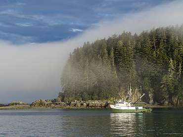 The fishing boat Steller anchored in the fog at George Island, Cross Sound, Southeast Alaska, United States of America