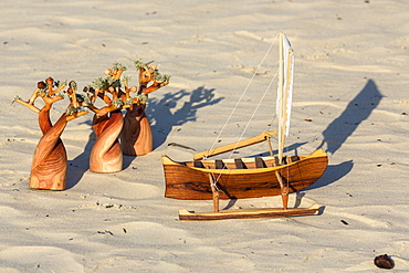 Woodcarvings in the sand, souvenirs, Baobab, Pirogue, Morondava, Madagascar, Africa