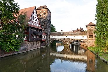 View of max bridge, the river Pegnitz, half-timbered building of the Weinstadel, water-tower and Henkersteg footbridge, Nuremberg, Middle Franconia, Bavaria, Germany