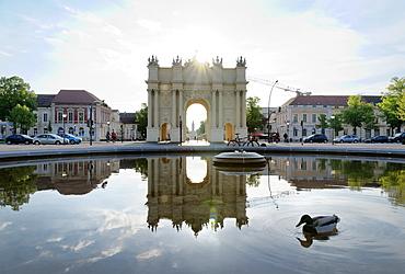 Fountains at the Brandenburg Gate with reflection, Luisenplatz, Potsdam, Brandenburg, Germany