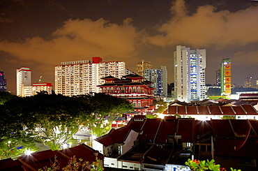 Buddha Tooth Relic Temple and Museum infront of skyline at night, Chinatown, Singapore