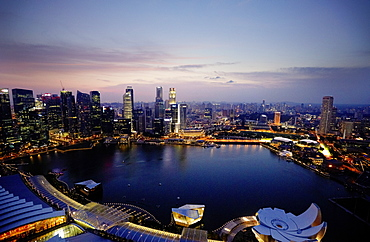 View over Marina Bay to skyline at night, Downtown core, Singapore