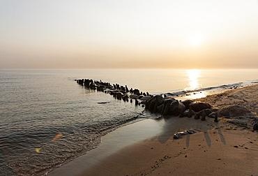 Old groynes in Kuehlungsborn West at sunrise, Seaside resort of Kuehlungsborn, Baltic Sea, Mecklenburg-Western Pomerania, Germany