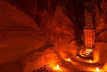 View through The Siq to Al Khazneh at night, Petra, Jordan, Middle East