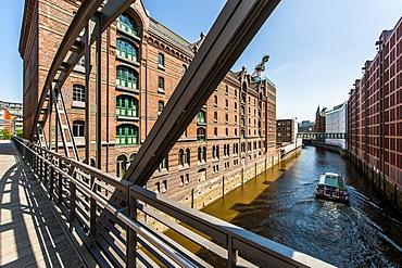 Excursion boat passing Speicherstadt, Hamburg, Germany