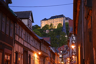 Alley with timbered houses and view to castle, Blankenburg, Harz, Saxony-Anhalt, Germany, Europe