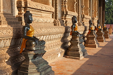 Buddhistic sculptures at the temple Wat Ho Phra Keo in Vientiane on the river Mekong, capital of Laos, Asia