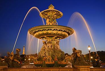 Place de la Concorde with fountain at night, Paris, France, Europe