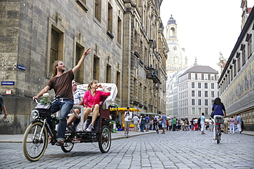 Tourists in a trishaw visiting old town, Dresden, Saxony, Germany