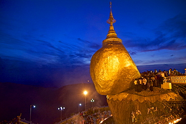 Buddhist pilgrims at the Golden Rock to celebrate November fuell moon Tazaungdaing, Kyaiktiyo, Mon State, Myanmar