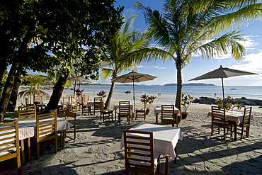 Dining tables under palm trees, Ngapali, most famous beach resort in Burma at the Bay of Bengal, Rakhaing State, Arakan, Myanmar, Burma