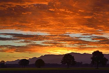 Mood of clouds above the Chiemgau range with Hochgern, Kampenwand and Hochries, Bad Feilnbach, Upper Bavaria, Bavaria, Germany