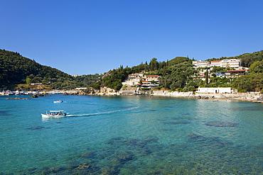 Excursion boat at Alipa Bay, Paleokastritsa, Corfu island, Ionian islands, Greece