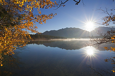 Sunrise, view over Barmsee lake to the Soiern mountains and Karwendel mountains, near Mittenwald, Bavaria, Germany