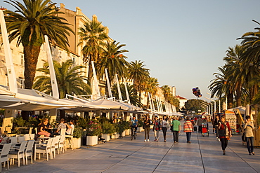 People sitting in outdoor cafes along The Riva seafront promenade, Split, Split-Dalmatia, Croatia