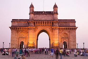 People in front of The Gateway to India at dusk, Mumbai, Maharashtra, India