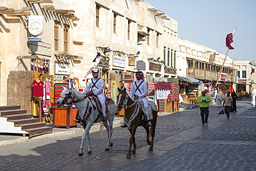 Police officers on horseback patrol at Souq Waqif, Doha, Qatar