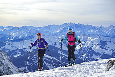 Two female back-country skiers ascending to Marterlkopf, Steinernes Meer, Berchtesgaden Alps, Salzburg, Austria